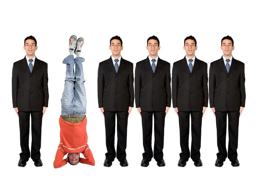 business people in a series with a casual guy doing the headstand.jpeg